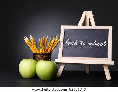 green apples and  blackboard with back to school text on it