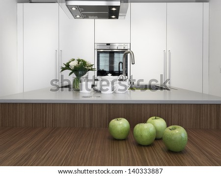 green apples and dishes on the wood worktop in the modern kitchen with vase of flowers