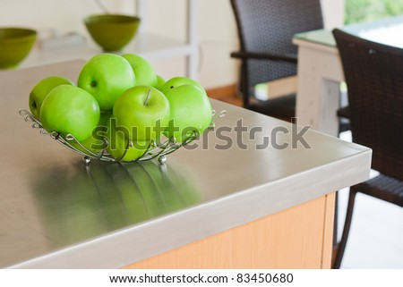 Green apples on table in modern kitchen