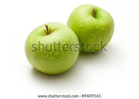 Green apples on the white background