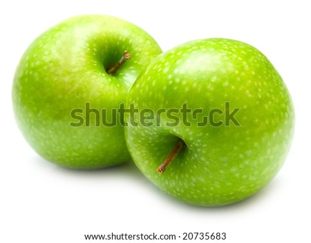 Green apples on the white background. Isolated. Shallow DOF