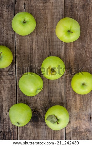Green apples on the wooden background
