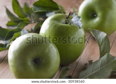green apples on wood background