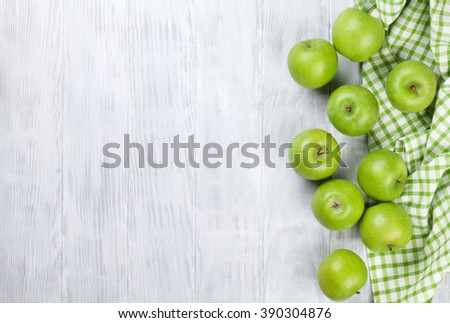 Green apples over wooden table. Top view with copy space
