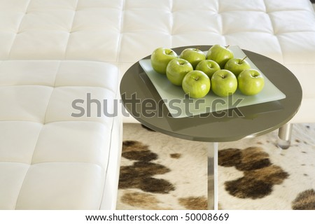 Green Apples Sitting On A Square Frosted Glass Plate On A