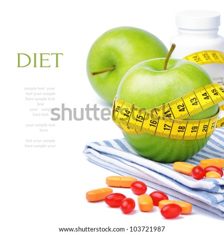 Green apples, vitamins and measuring tape. Diet concept