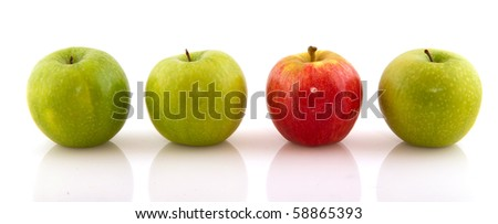Green apples with single red one isolated over white