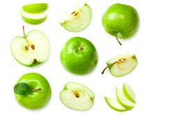 green apples with slices isolated on white background. top view