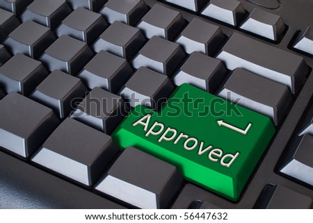 Green Approved button on black keyboard