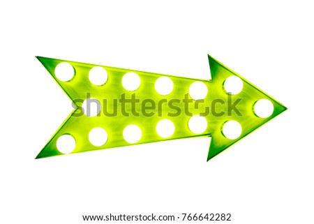 Green arrow as a vintage bright and colorful illuminated display frame with light bulbs isolated on a white background
