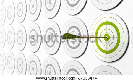 green arrow hitting the center of a green target there is grey targets around - stock photo