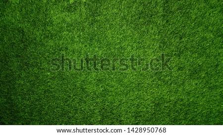 Green Artificial Grass Texture Background Close-up