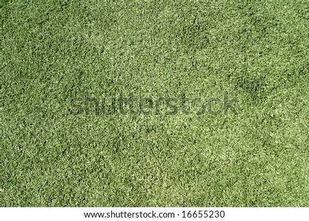 Green artificial lawn on a sports field for football
