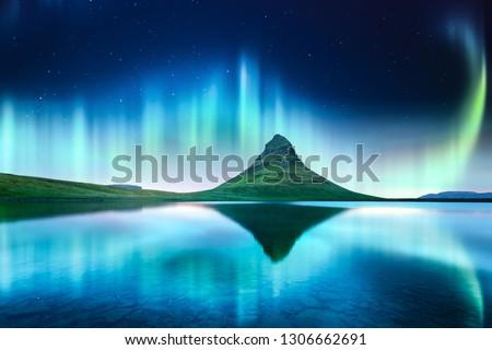 Green aurora light behind kirkjufell mountain in Iceland, Europe