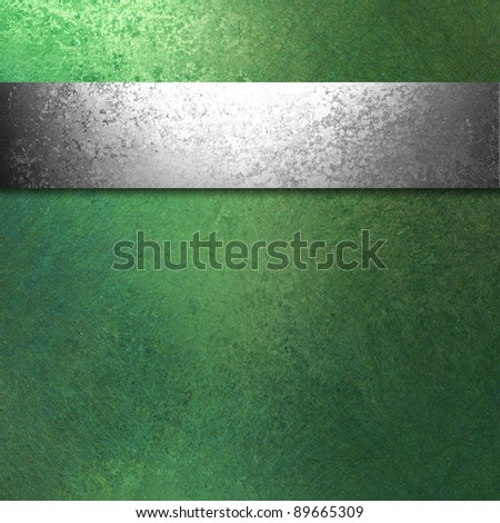 green background with silver ribbon stripe design on border of frame with vintage grunge texture and copy space for Christmas or St. Patrick's Day