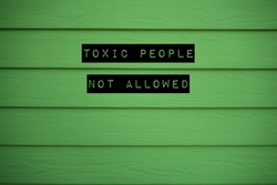 Green background with text TOXIC PEOPLE NOT ALLOWED, concept of avoiding negative vibes people who behave toxically to upset or impact others , should cut them out from life before getting drained