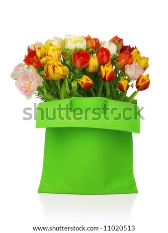 green bag with beautiful tulip bouquet . isolated on white background