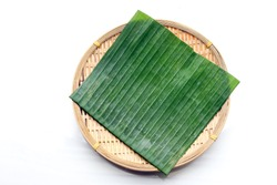 Green Banana Leaf on bamboo tray plate texture background