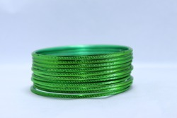 Green Bangles Isolated On White Background. Selective focus o green bangles.