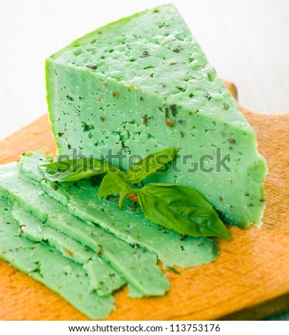 stock-photo-green-basiron-pesto-cheese-1