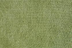 green bath towel with loops texture closeup