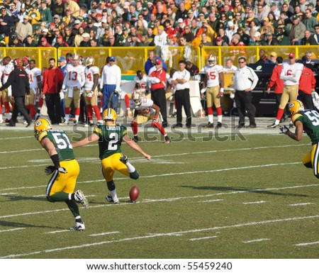 GREEN BAY, WI - NOVEMBER 22 : Green Bay Packers kicker Mason Crosby prepares to kick off in a game at Lambeau Field against the San Francisco 49ers on November 22, 2009 in Green Bay, WI