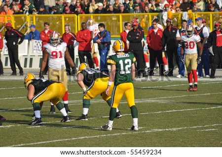 GREEN BAY, WI - NOVEMBER 22 : Green Bay Packers quarterback Aaron Rodgers prepares to take a shotgun snap in game at Lambeau Field against the San Francisco 49ers on November 22, 2009 in Green Bay, WI