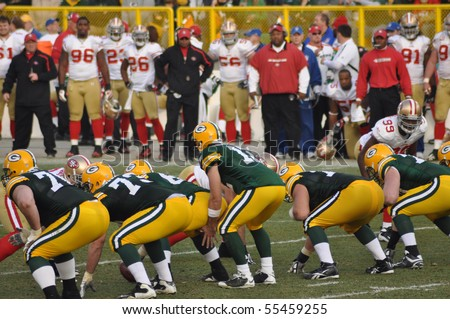 GREEN BAY, WI - NOVEMBER 22 : Green Bay Packers quarterback Aaron Rodgers prepares to take the snap in a game at Lambeau Field against the San Francisco 49ers on November 22, 2009 in Green Bay, WI