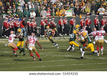 GREEN BAY, WI - NOVEMBER 22 : Green Bay Packers receiver Jordy Nelson returns a kick-off in a game at Lambeau Field against the San Francisco 49ers on November 22, 2009 in Green Bay, WI