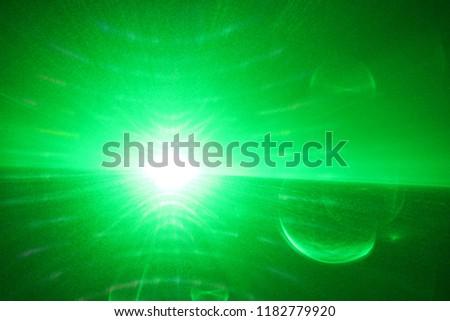 green beam  laser beam on dark background #1182779920