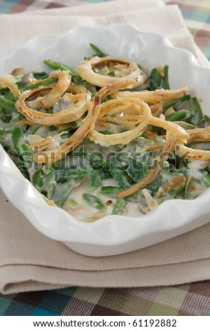 Green bean casserole - a traditional Thanksgiving side dish. Green beans mixed with cream of mushroom soup and topped with french-fried onions.
