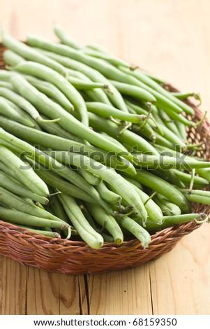 green bean pods in basket