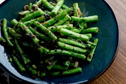 Green beans or haricots. Sautéed organic vegetable in olive oil, herbs, spices and salt and pepper. Classic American steakhouse, restaurant or bistro side dish.