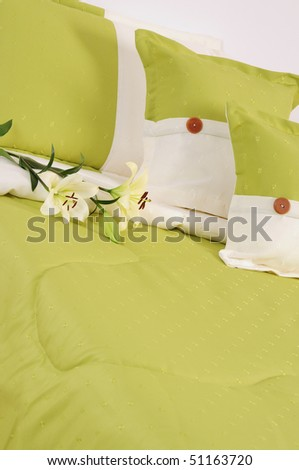 Green bed with flower. Hospitality concept.