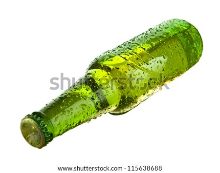 Green beer bottle lying  over white background
