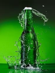 Green beer bottle splash