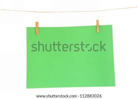 green blank paper sheet on a clothes line. Isolated on white background.