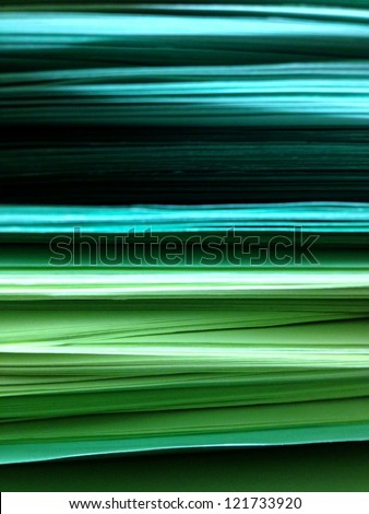 Green Blue Pile of Papers Background