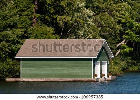 Green boathouse - stock photo