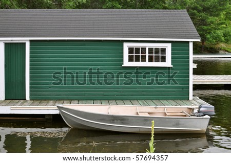 Green boathouse and aluminum boat