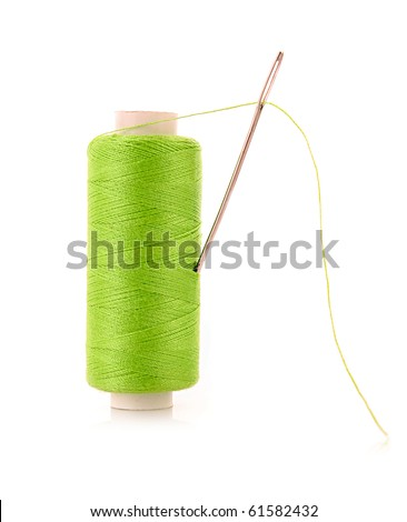 green Bobbin with needle isolated on white