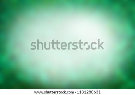 Green bokeh nature defocus blur background. Defocused abstract background #1131280631