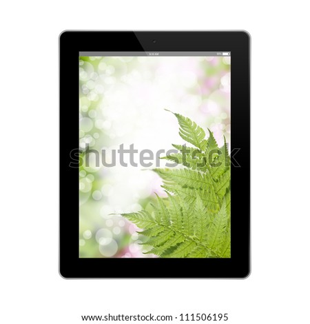 green bokeh wallpaper in tablet pc isolated on white background