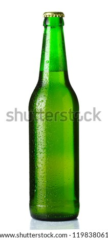 Green bottle of beer with drops on white background