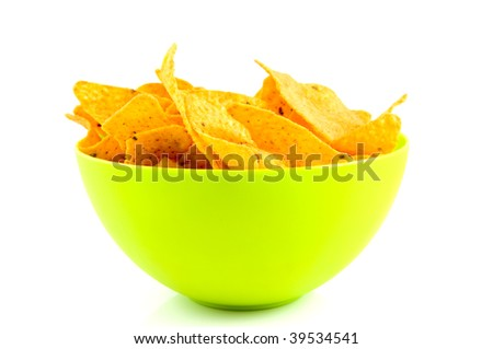 Green bowl with tortilla chips isolated on white background