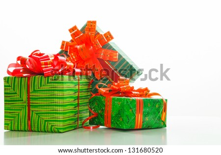 Green boxes with presents against white background