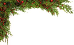 Green branches and pine cone with red christmas decoration on white