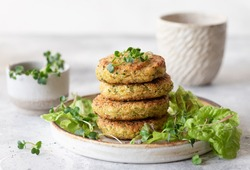 Green broccoli and quinoa burgers served with lettuce and microgreens. Tasty vegan food. close-up