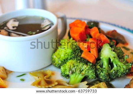 Green broccoli set meal with broiled mushroom soup for a healthy meal.