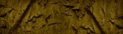Green brown abstract background. Grunge banner with rock texture. Close-up. The combination of khaki color and rough mountain texture. Toned stone background.